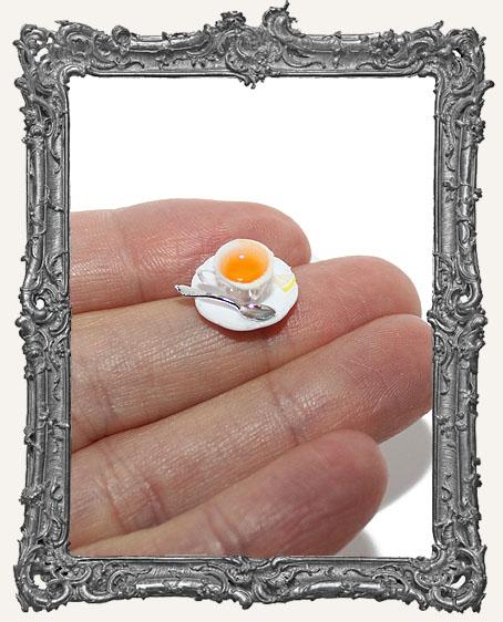 Miniature Cup of Hot Tea with Lemon