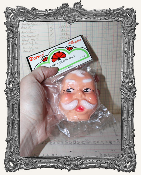 One Vintage New in Package Santa Claus Doll Face